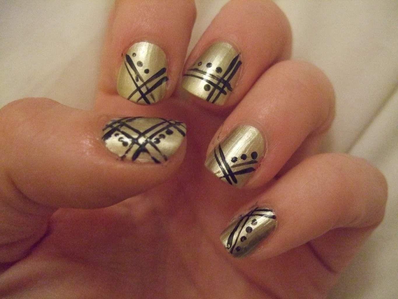 Black nails with gold tips