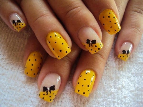 yellow with black dots nail ideas