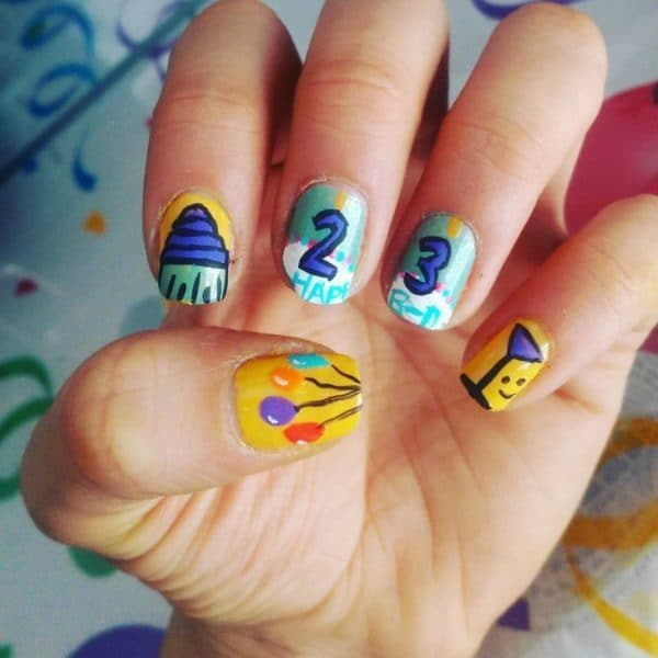 Yellow And Aqua Nail design for birthday