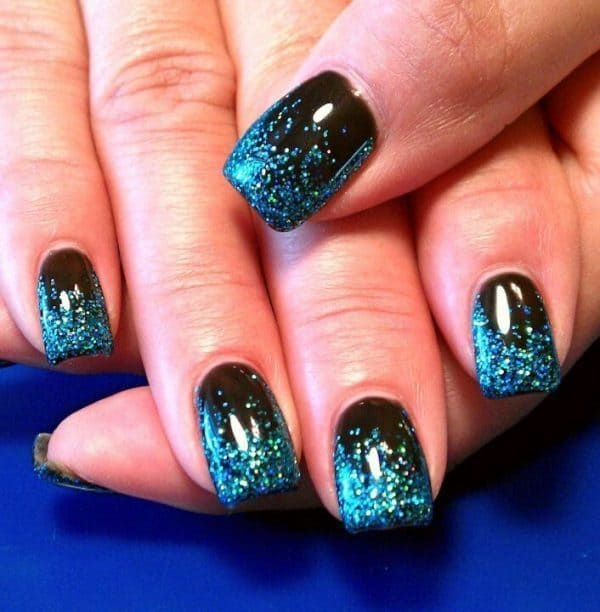 black and blue shimmer nails with glitter