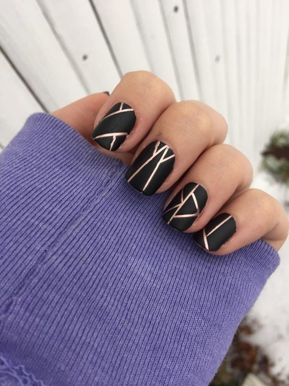 black and gold nail line design