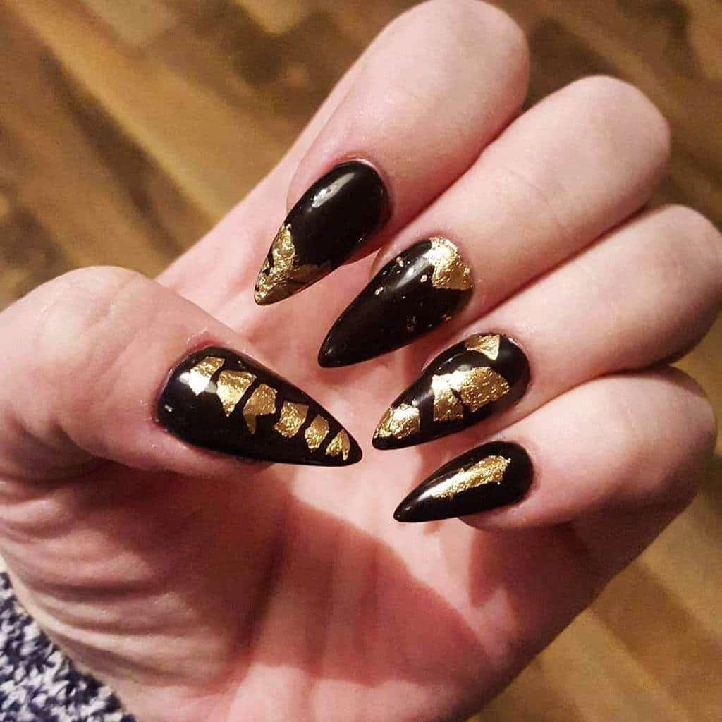 Shiny black and gold nail art