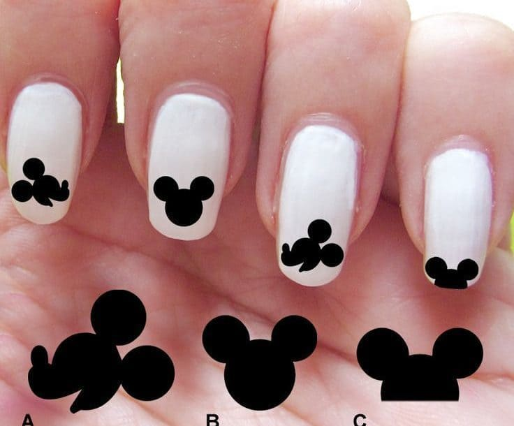 White and black mickey mouse nail art