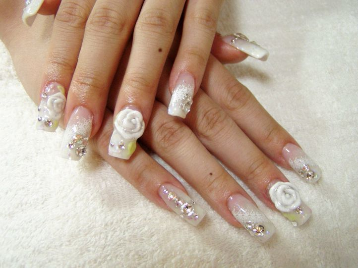beautiful white nail design with rhinestones