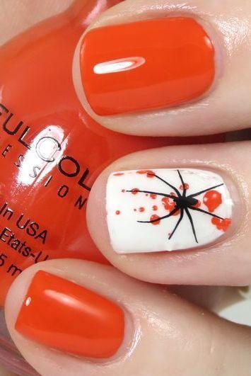 white and orange nail design