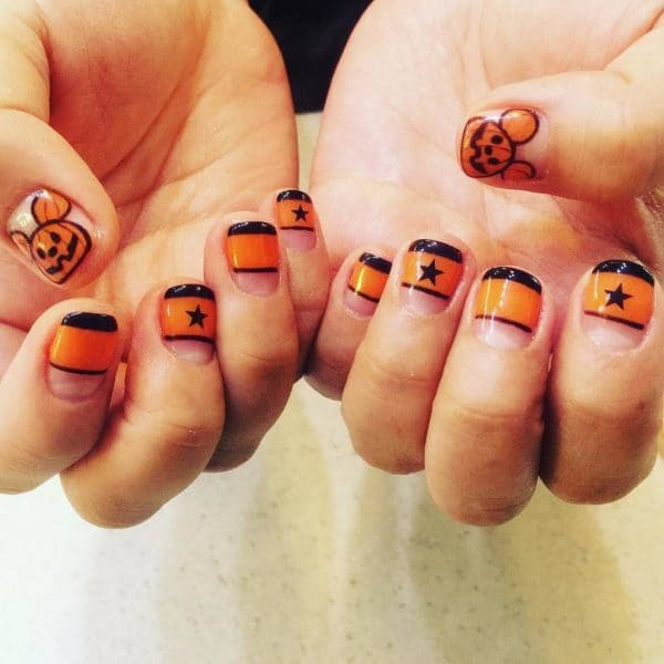 black and orange nail design