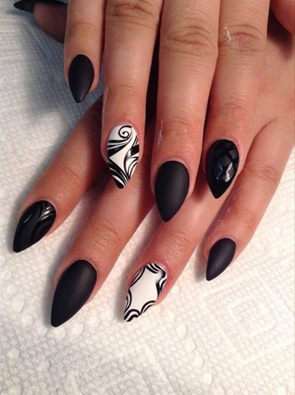 Swirly Black stiletto nail art for girl