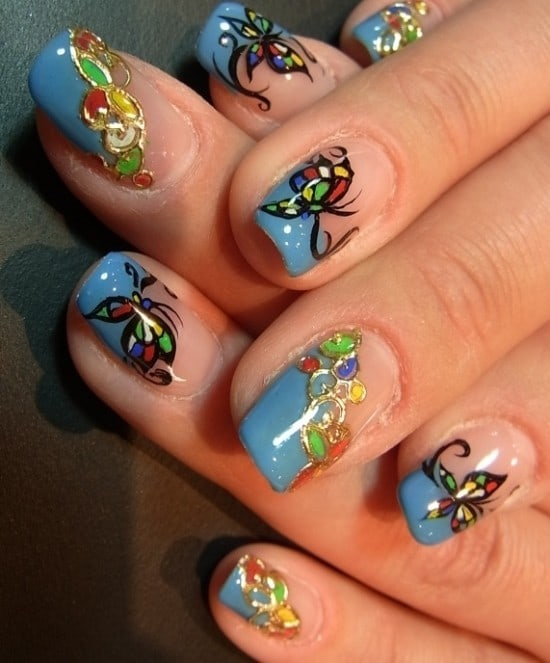 blue butterfly nail design