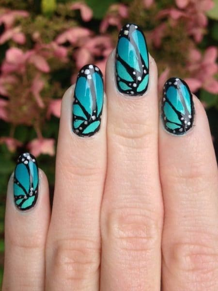 blue wings butterfly nail design
