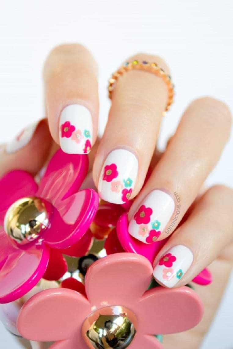 20 hottest spring nail designs to celebrate the season in a normal clear white nail design you better give your feminine nails a little touch that provides you with the spring spirit you are searching for from prinsesfo Choice Image