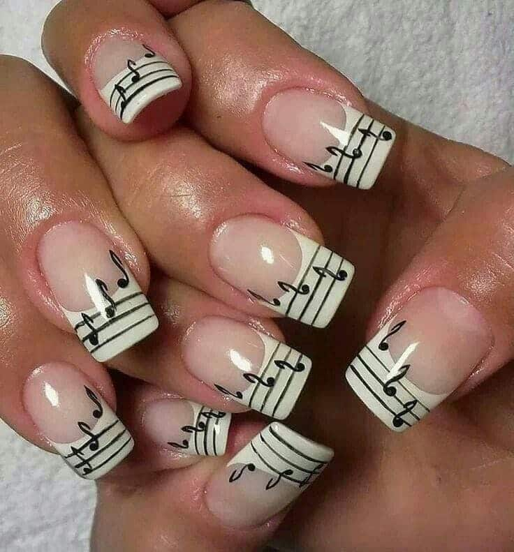 So in this music note nail design, you can see a lot of French details.  French manicure paired up with the music notes, a clef, ... - 20 Coolest Music Note Nail Designs You'll Love – NailDesignCode