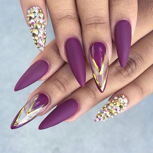 These nails are just to die for. Our dope nail design list wouldn't be  complete if there wasn't a beauty as this one. Magnificent purple with  golden gems ... - 20 Epic Dope Nail Designs For Trendy Women – NailDesignCode