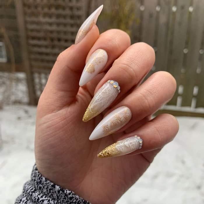 White And Gold Stiletto Nails