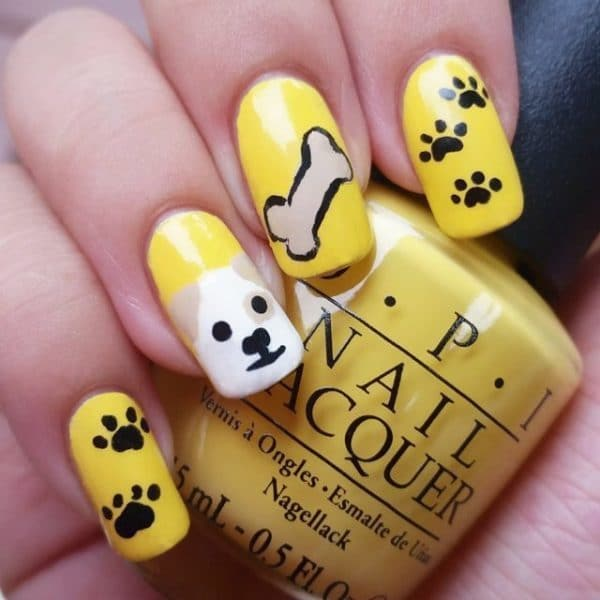 Yellow Bone dog nail art