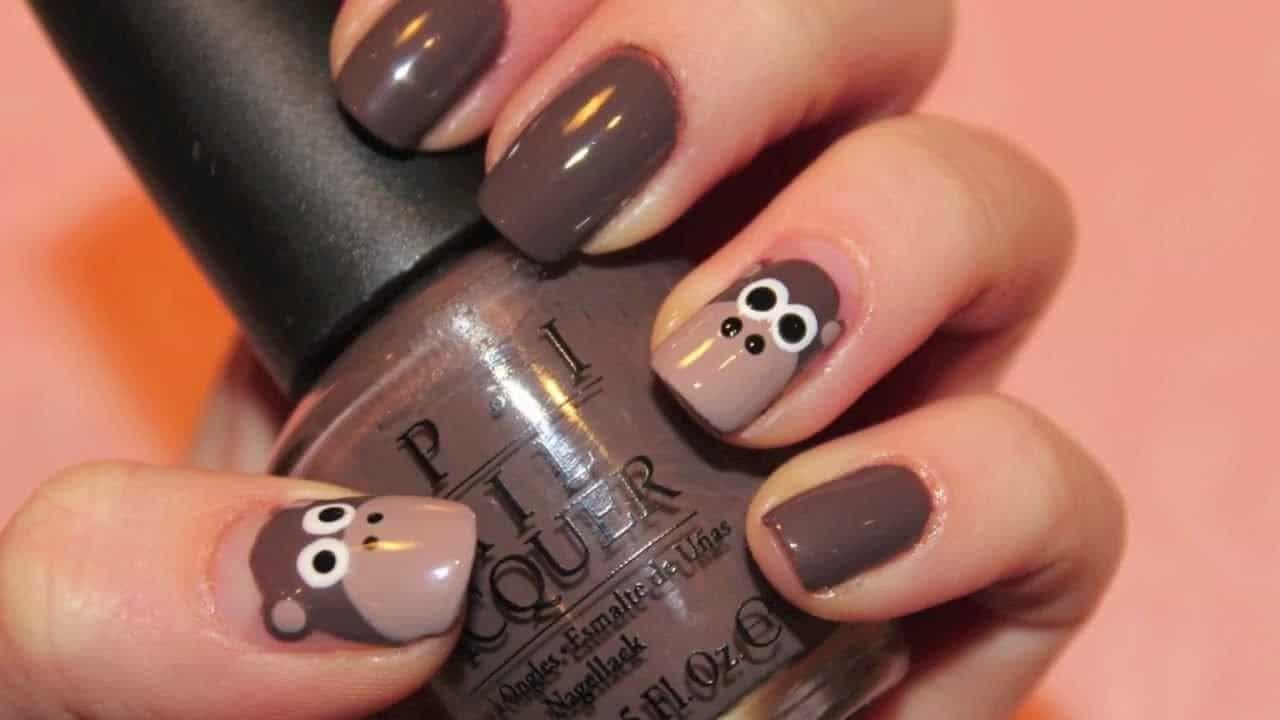 animal print nail design with funny monkey