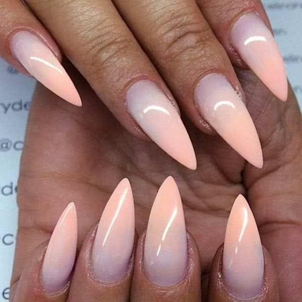 Sharp pointy ombre peach color nail design that requires a license!  Although this peach color is fading, these nails are definitely not! - 20 Stylish Peach Nail Designs For Christmas Eve – NailDesignCode