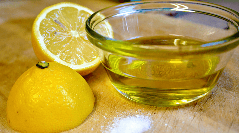 Bowl of Olive Oil and a Lemon