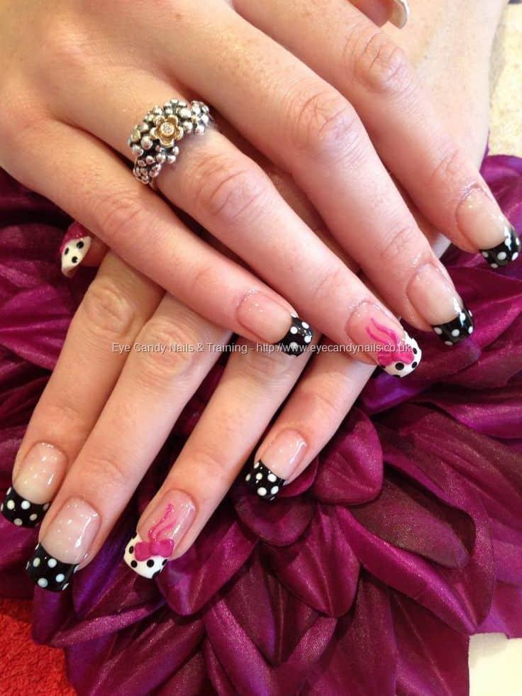 Polka dot bow nail art