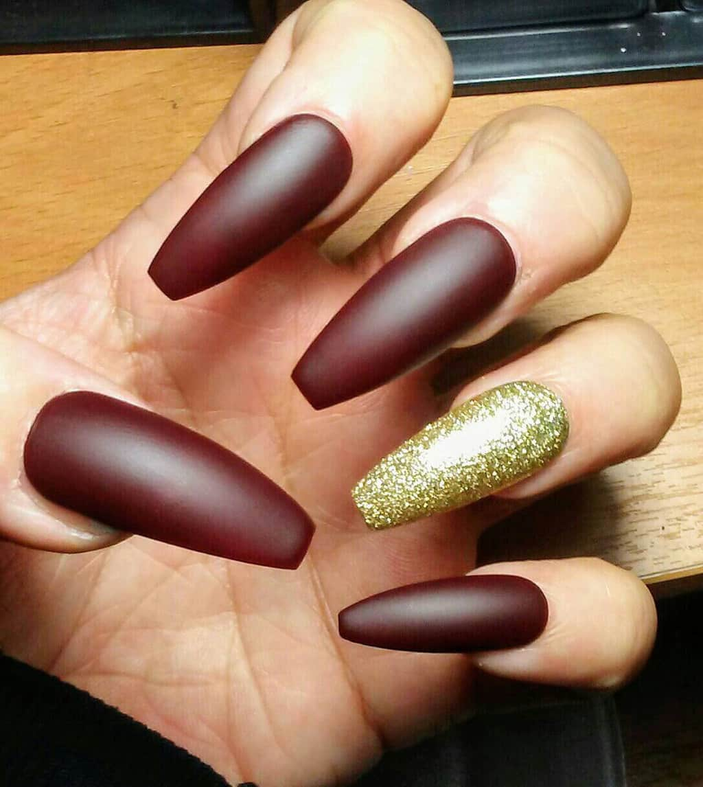 Long Maroon and Gold Nail design