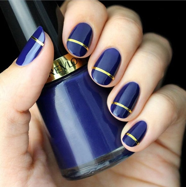 royal blue nail design with one golden line