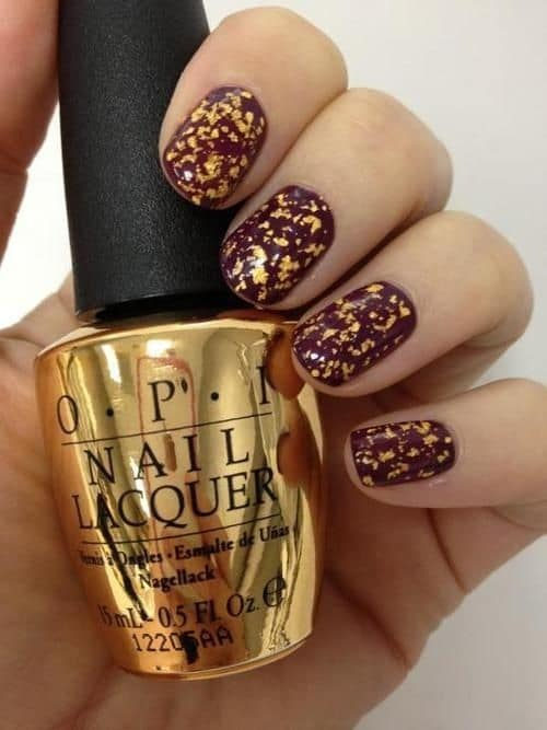 OPI Maroon and gold nails