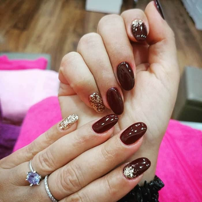 maroon and gold acrylic nails