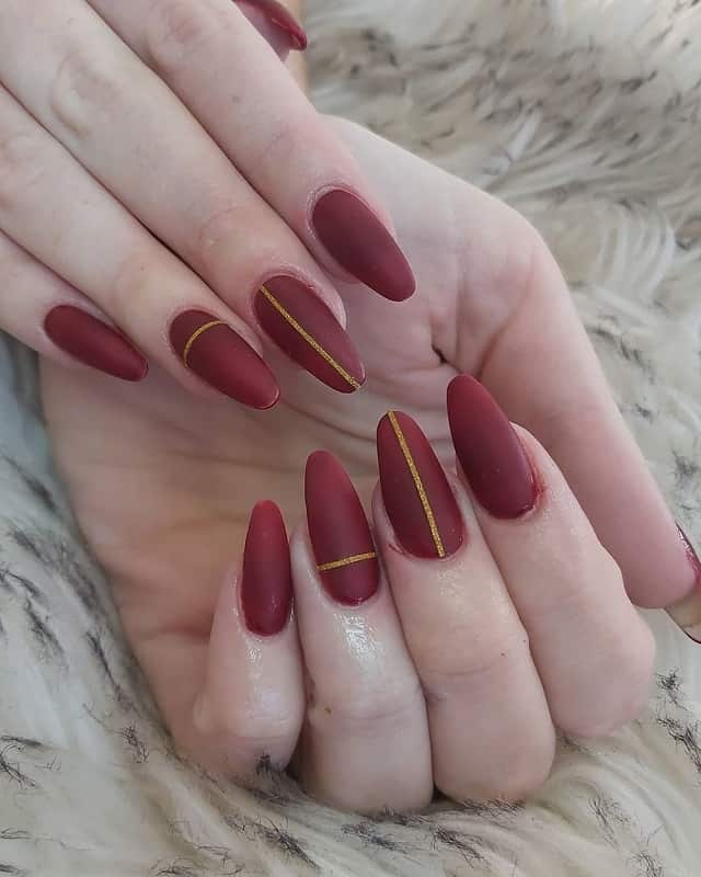 maroon color oval nails polish