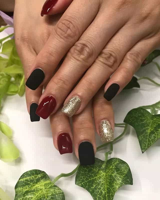 black, gold and maroon nails
