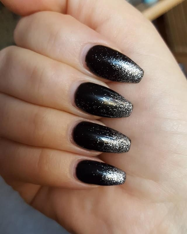 black nails with silver tips