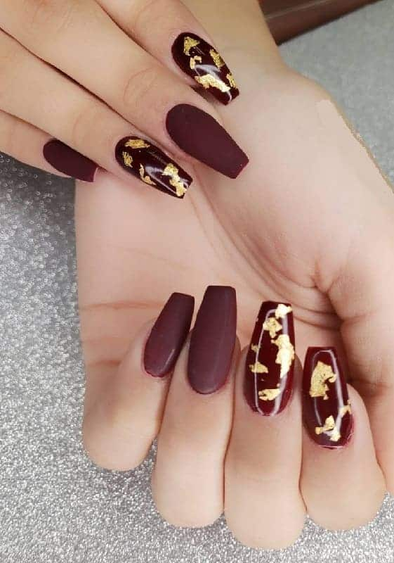 maroon and gold coffin nails
