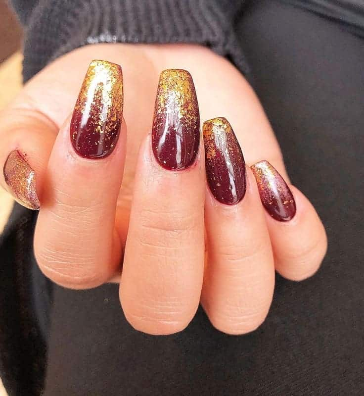 maroon and gold ombre nails