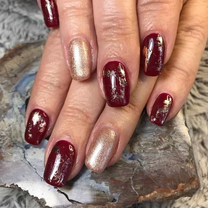 maroon and rose gold nails