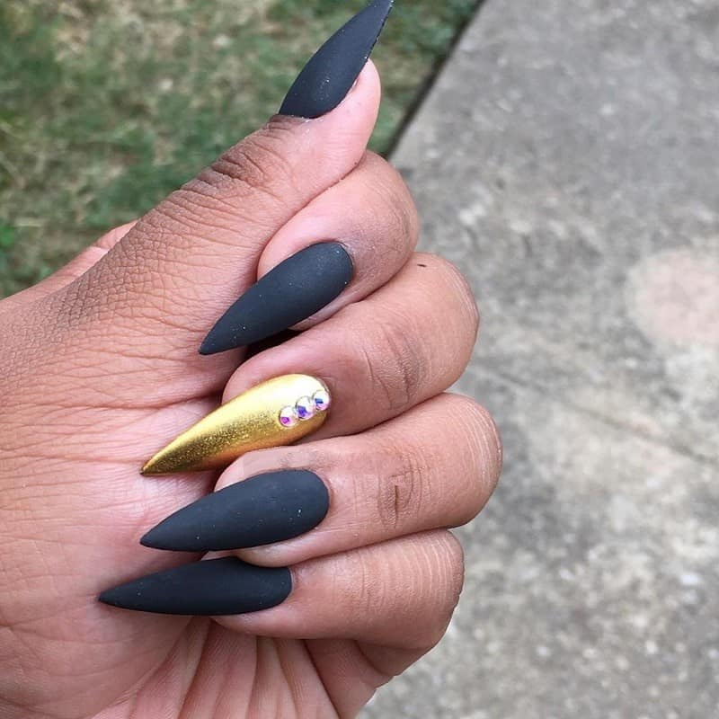 matte black and gold stiletto nails