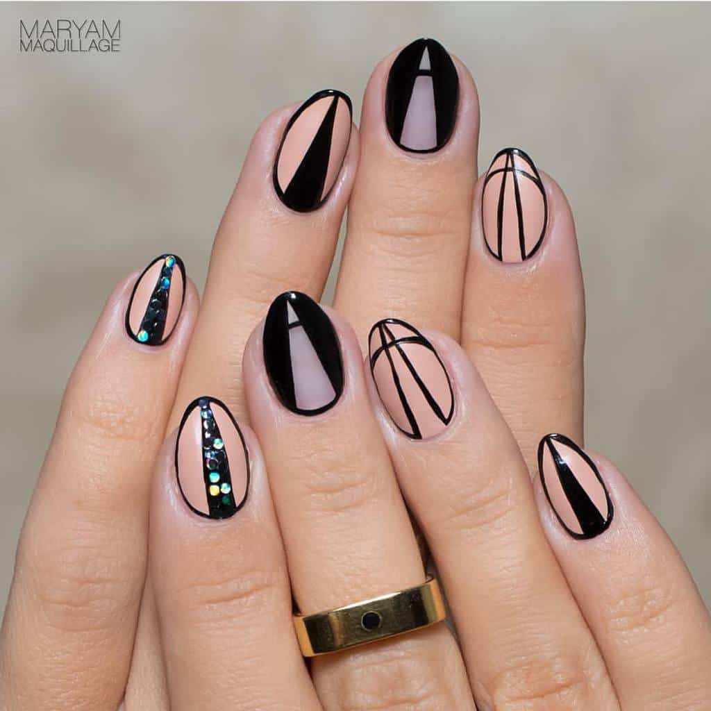 Black And Nude Short Oval Nail