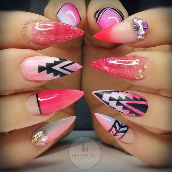 stiletto nail design in tribal vibe