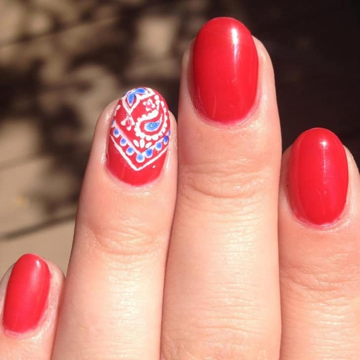 Artistic Red Round Nail Design