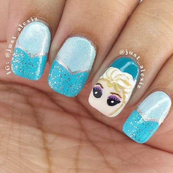 This Is Very Simple Frozen Nail Design Paint All Your Nails With Two Shades Of Sky Blue Use Some Silver Glitters On Them Then Draw A Pair Eyes Elsa