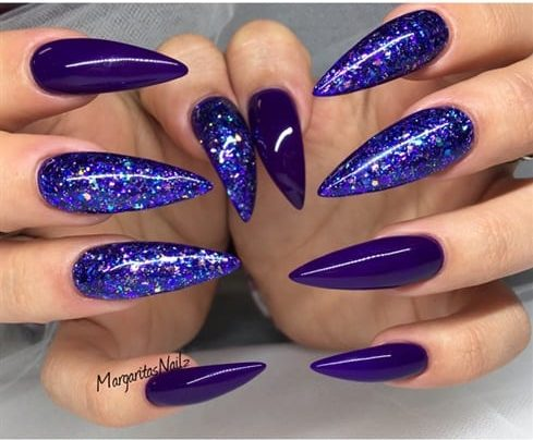 Glowing Blue Stiletto nails
