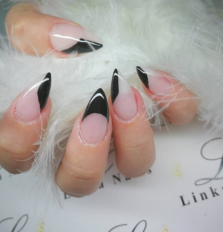 nude and black stiletto nails