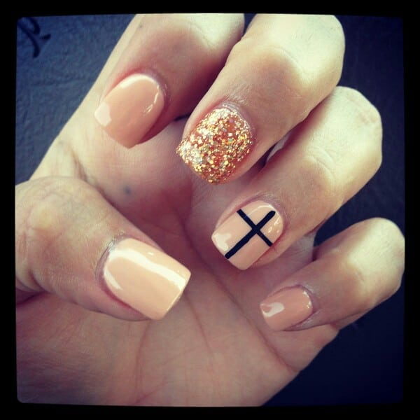 A glittery golden nail associated with a black cross is the theme of this  design. You can have these cross nail designs done very easily. - 20 Cross Nail Designs To Uphold Your Christianity – NailDesignCode