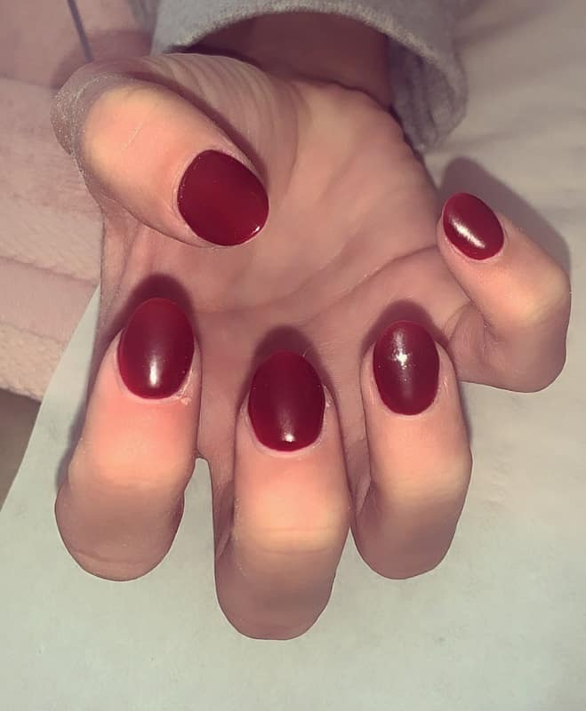 round acrylic dark red nails