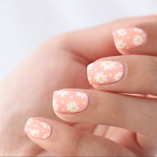 daisy nail design on pastel nail