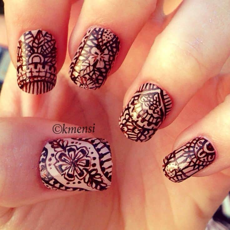 cohesive henna nail design