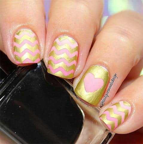 25 hearty heart nail designs to ignite romantic soul this design is so chic that anyone will fall in love with this design design all the nail with chevron pattern then accentuate one nail with heart shape prinsesfo Image collections