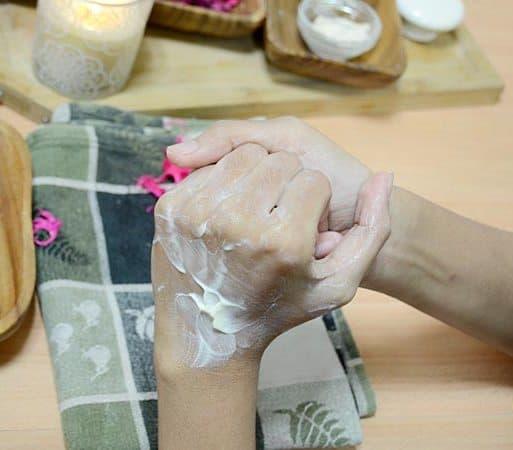 Applying moisturizer on hands
