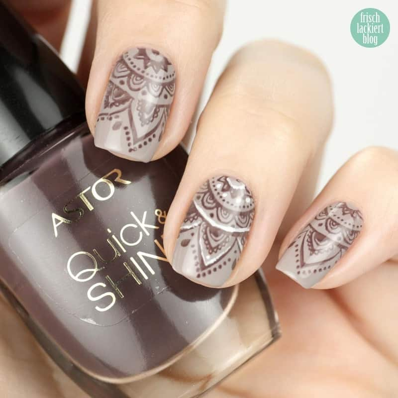 henna nail art on grey base