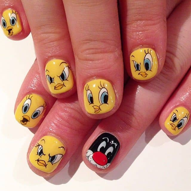 Tweety is a sweet cartoon character. You will fall in love with this cute  little yellow bird. Paint the images of sweet tweety little bird with  yellow nail ... - 20 Cutesy Cartoon Nail Art For Reminiscing Childhood
