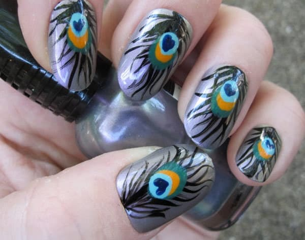 hand painted peacock feather nail art