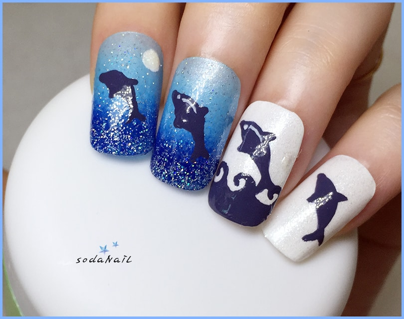 You can use glitters to make your dolphin nail art joyful. That extra shine  adds extra beauty to these nail art. You can paint dolphins on glittery  blue ... - 15 Delightful Dolphin Nail Art To Slay The Summer