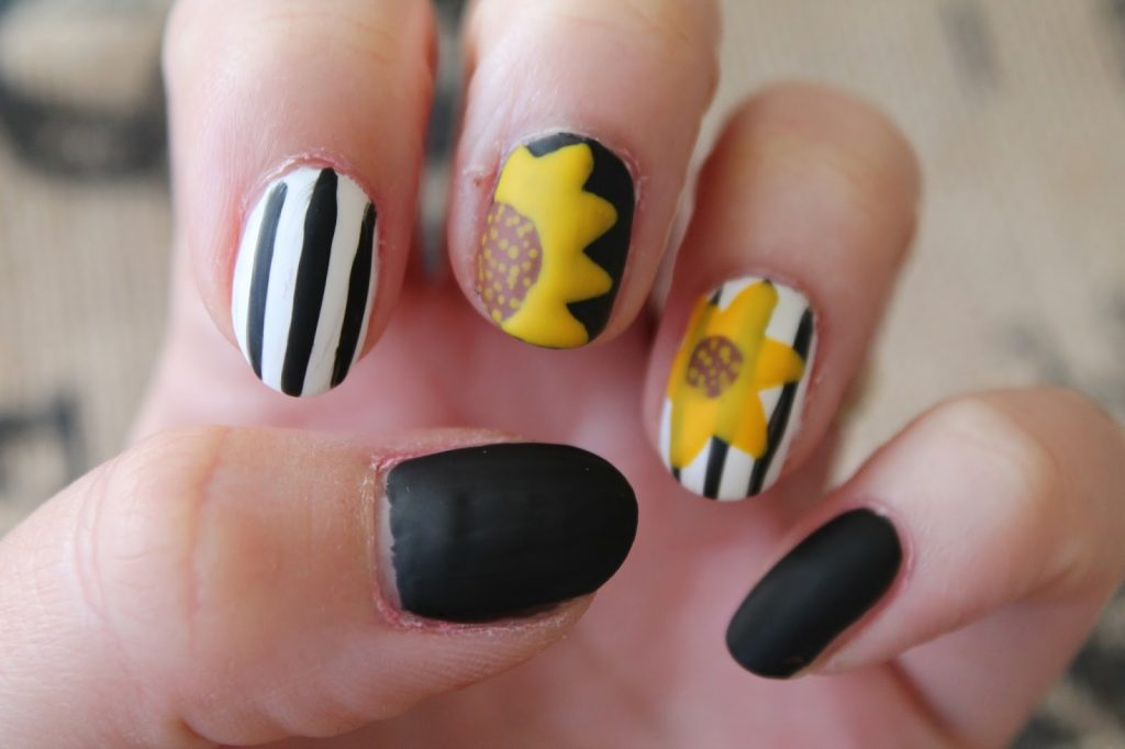 black and white sunflower nail art
